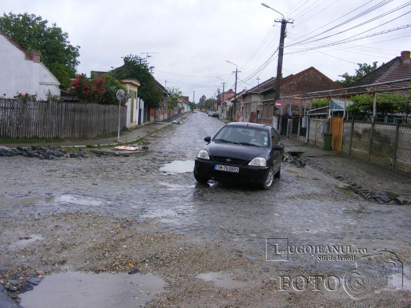 strada vlad tepes lugoj gropi noroi apa asfalt foto galerie mai 2014 lugojeanul foto (1)